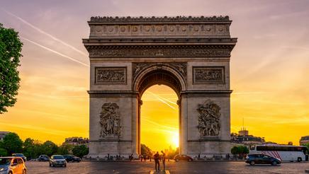 Paris Arc de Triomphe on Champs-Élysées at sunset