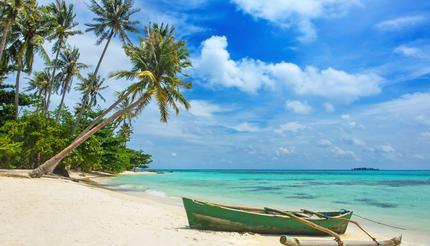 Boat on the beautiful tropical beach of Karimunjawa island, Indonesia