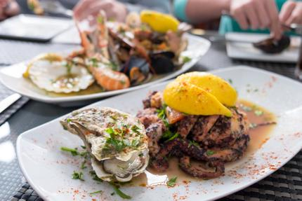 Enjoy fresh seafood in Marsaxlokk, Malta