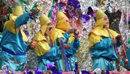 Krewe throwing beads Mardi Gras