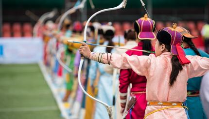 Naadam Festival-Women taking part in archery