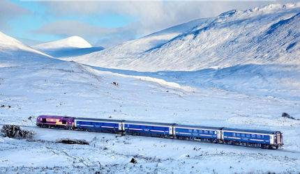 The Caledonian Sleeper scythes through the snow