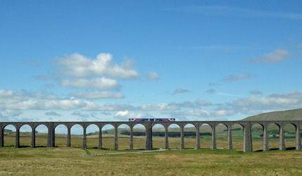 A train crosses Ribblehead Viaduct in North Yorkshire