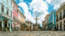 The 10 most dangerous cities worth visiting - Abandoned cobbled street with cross in the background