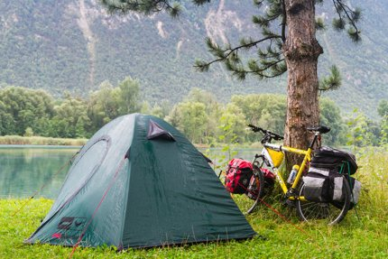A tent and a sleeping bag are common items
