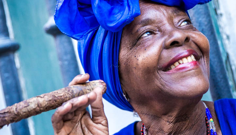 24 hours in: Havana - Portrait of cuban woman smoking cigar in Havana, Cuba