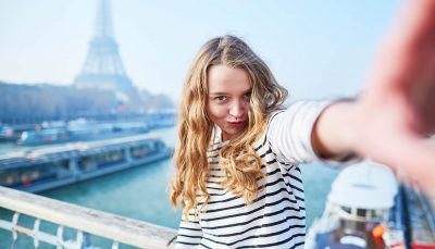 A woman talking a selfie near Eiffel tower, Paris