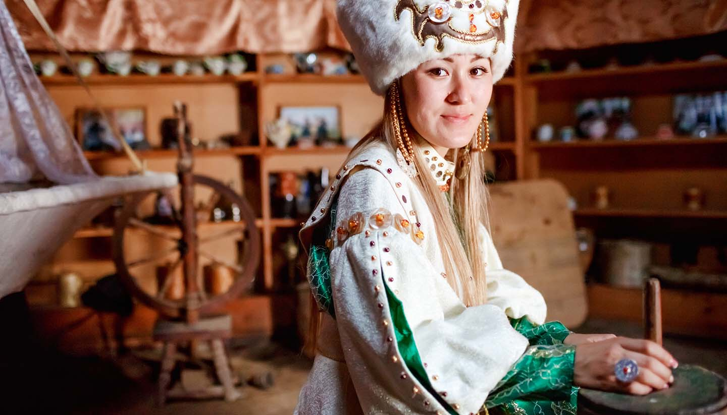 Kyrgyzstan - Young Woman in Traditional Yurt Dwelling