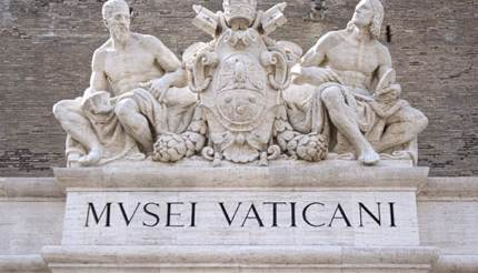 Statues above entrance to Vatican Museum