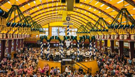 People drinking in the Lowenbrau Beer Tent