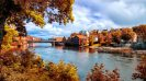 Top 5 places to see autumn foliage in Europe - View through autumn foliage to Nidelva river, Trondheim city, Norway