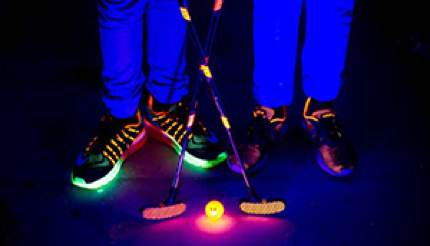 Two pairs of glowing shoes on children