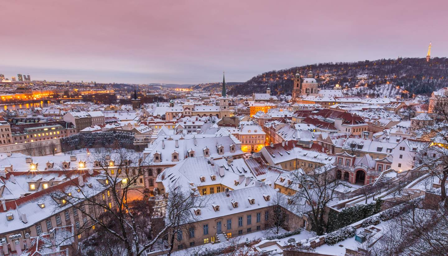 Where to go on holiday in December 2017 - Snow covered roofs in Prague