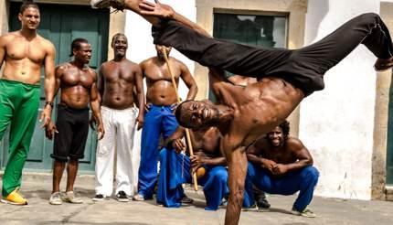 Men playing Capoeira