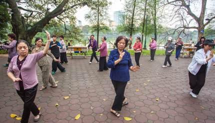 Seniors practicing Tai Chi by Hoan Kiem Lake