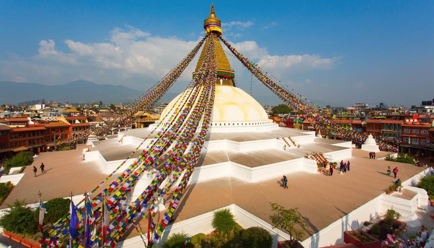 City Highlight: Kathmandu - People dotted around the Boudhanath stupa in Kathmandu