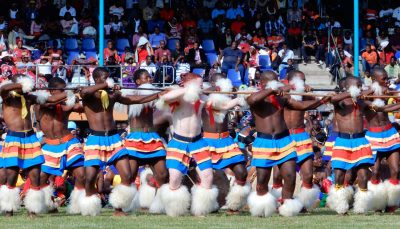 Bare chested Swazi men performing a ceremonious dance