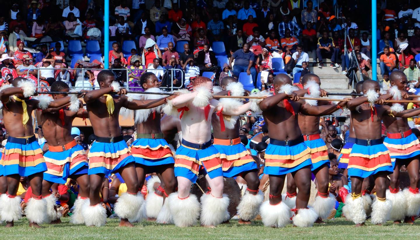 10 reasons to visit eSwatini (Swaziland) - Bare chested Swazi men performing a ceremonious dance