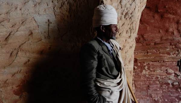 The kind priest of Abuna Yemata Guh standing by the door.