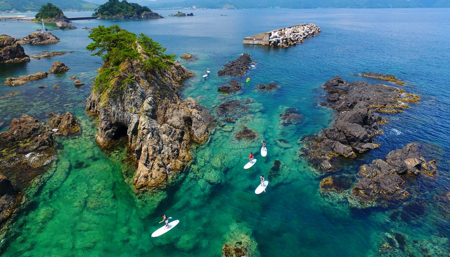 Japan's best-kept secret: the gorgeous beaches of Takahama town - People standup paddle boarding in Takahama, Japan