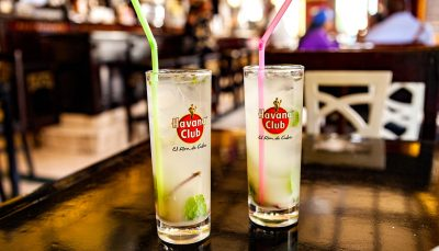 Two glasses of Havana Club with mint leaves and a straw each