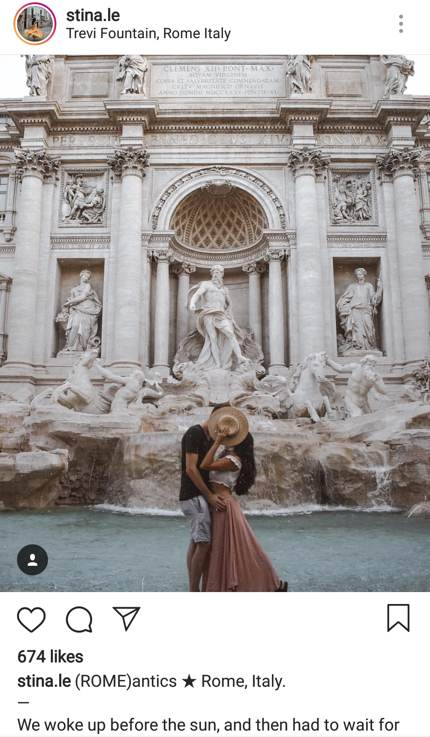 Couple kissing at the Trevi Fountain