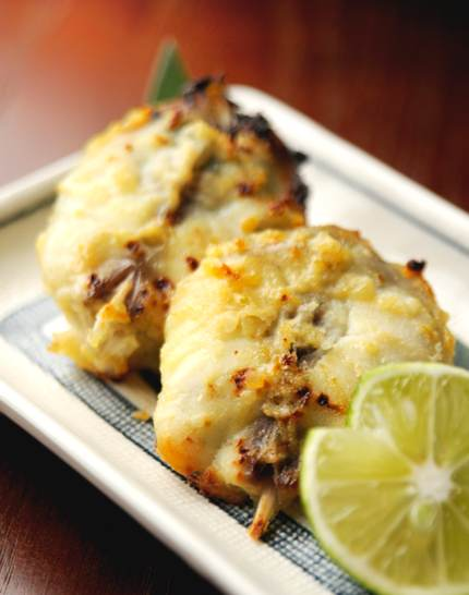 Two fried blowfish on rectangular plate with a slice of lime. Can be eaten in Takahama