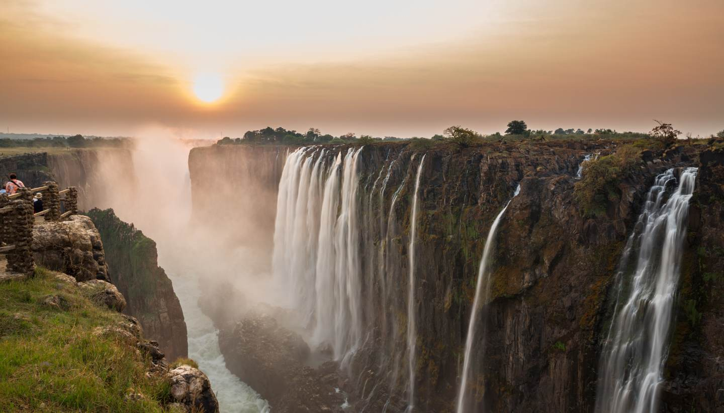 Where to go on holiday in September 2018 - Victoria Falls, view from Zambia at sunset