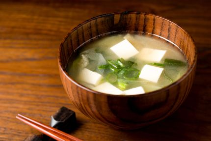 Miso soup in a small wooden bowl