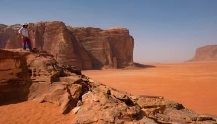 Woman admiring the view in Wadi Rum desert, Jordan