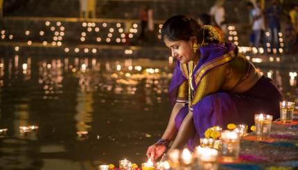 Woman lighting Diya in India