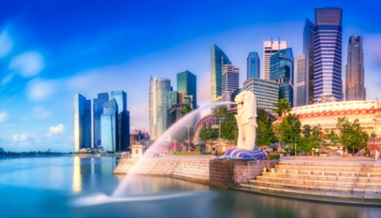 Wide shot of Singapore City with dragon waterfall in the evening