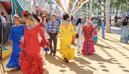 Locals in traditional costumes for Feria de Abril