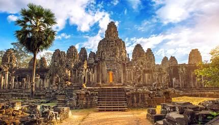 Ancient stone faces at sunset of Bayon temple, Angkor Wat, Siam Reap, Cambodia