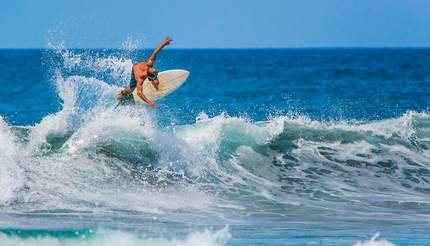 Surfer riding the waves of Costa Rica