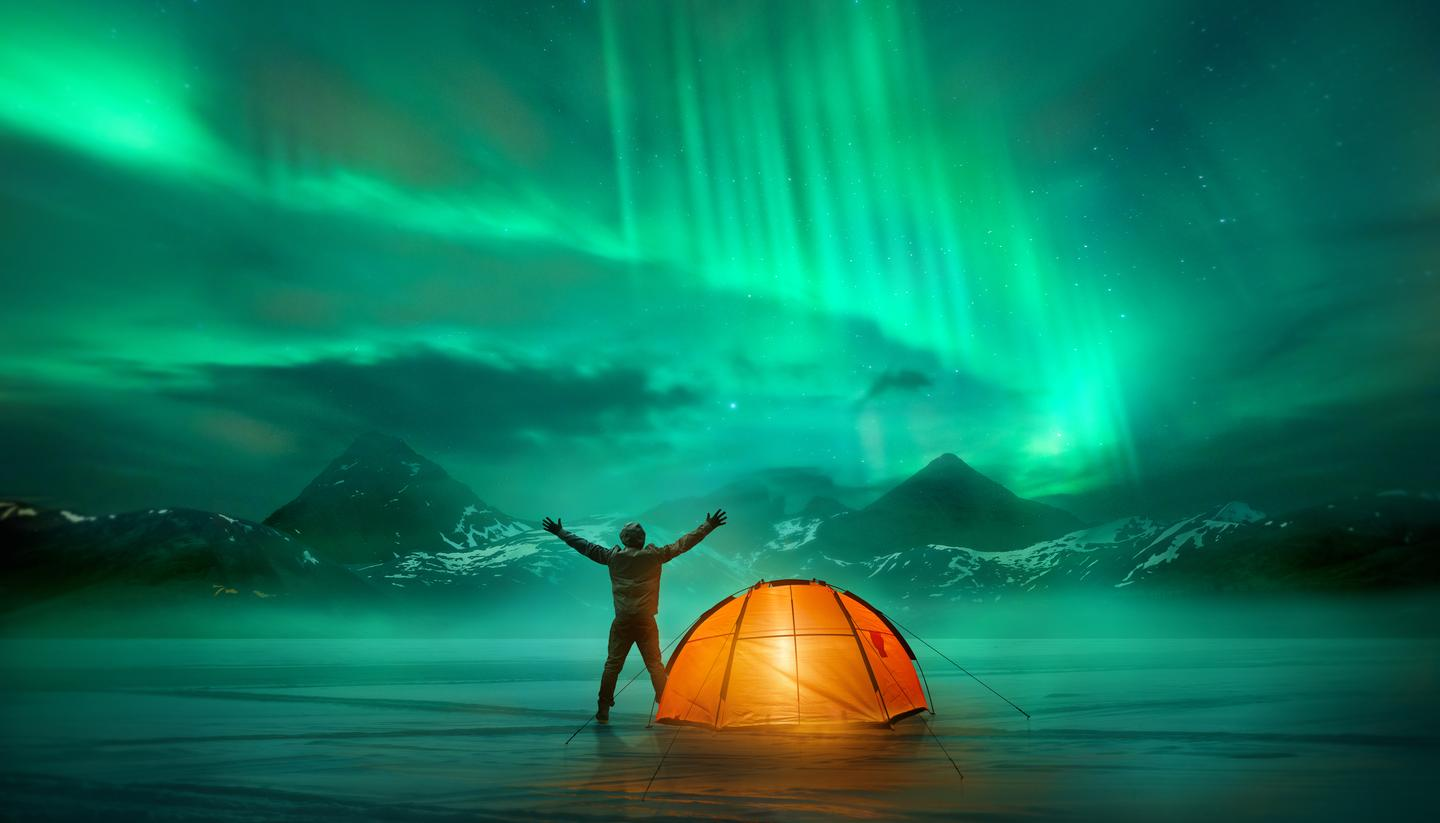 The wild camping survival guide - shu-Aurora-Borealis-Man-Camping-Triumphant-HERO-675590356-1440x823