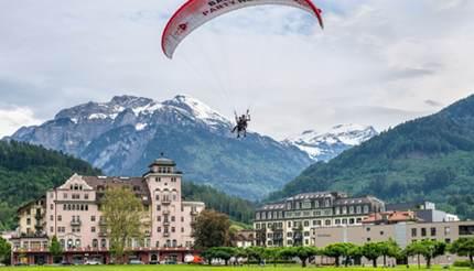shu-Switzerland-Interlaken-Paragliding-over-Interlaken-716541055-editorial-430x246