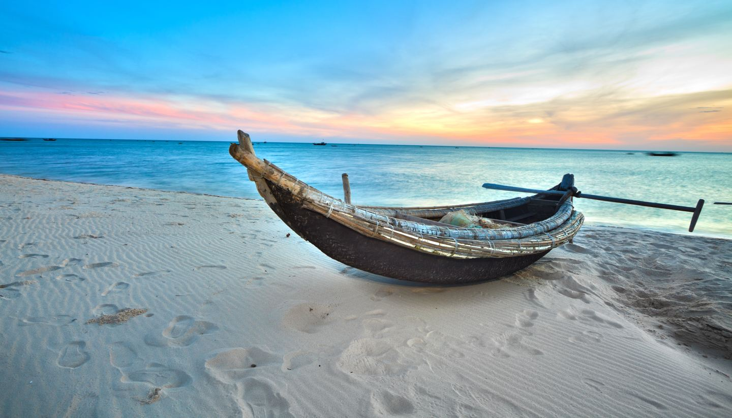 Home - A fisherman's boat at sunrise time, Hue province, Vietnam