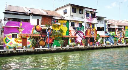 Street art on buildings along the Melaka River.
