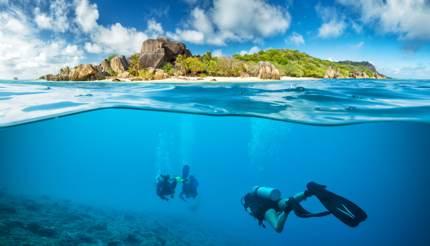 Scuba divers off the coast of Seychelles