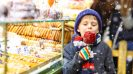 Top 10 Christmas markets in Europe - Child enjoying candy apple Christmas market