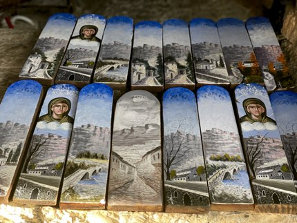 Ilios is the only monk at the Paraskevi Monastery; he also paints local scenery on small planks