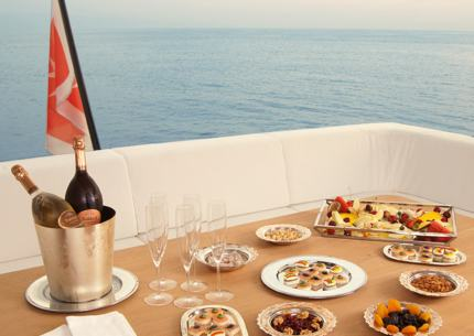 Fruit, snacks and wine on a table on the upper deck.