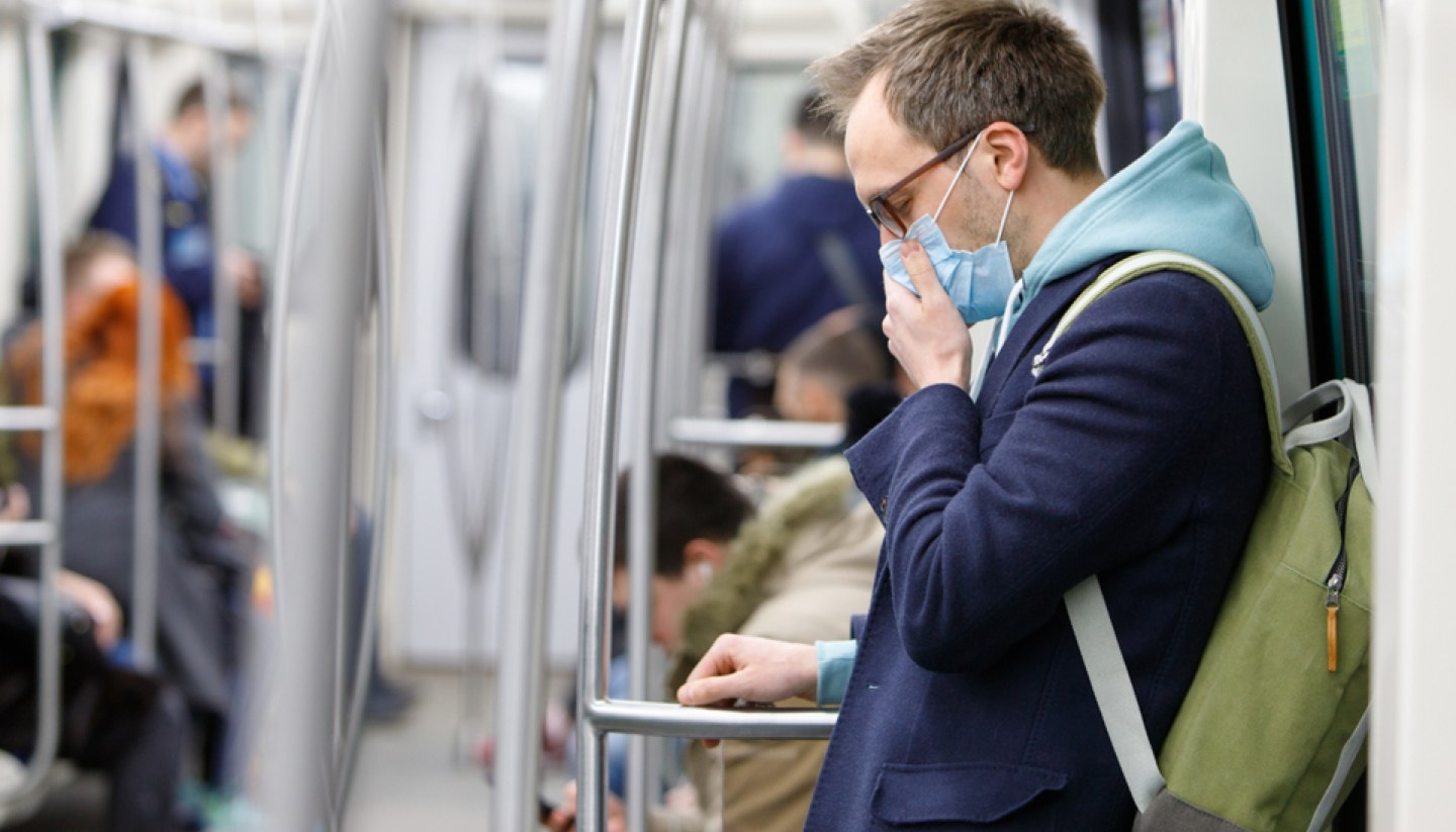 Can you travel safely when Coronavirus (COVID-19) is spreading fast? - Mask-wearing passengers on a train