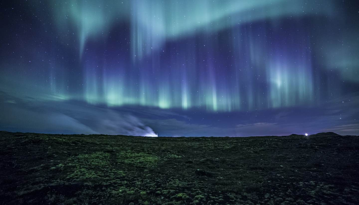 Top 5 places to experience supernatural forces - Aurora over a lava field