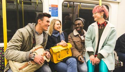 Friends travel by tube in London