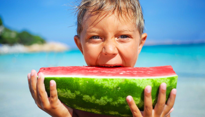 Home - Boy having a big slice of watermelon