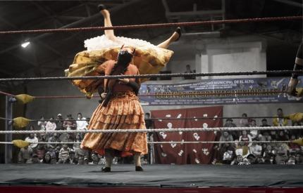 Two wrestling cholitas