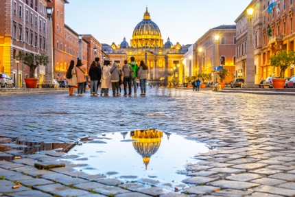 Tourists looking at St Peter's Basilica in Vatican City