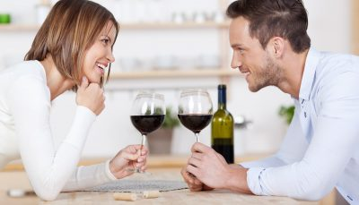 A couple sharing a bottle of wine